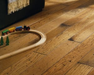 a childs playset close up on an oak wood flooring