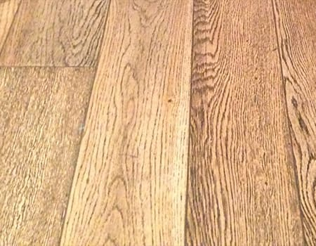 close up of a burshed solid wooden floor