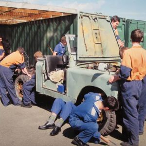 Whanganui High School students work on the Land Rover. Photo / Bevan Conley.
