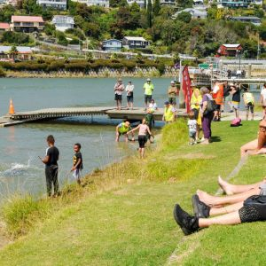 Spectators took to the banks of the Whanganui River to watch swimmers competing in the Bridge to Bridge swim. Photo / Lewis Gardner.