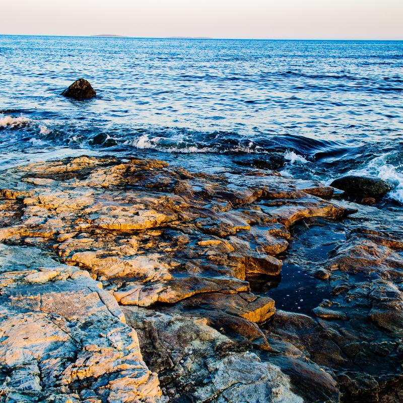rocks and water at seawall