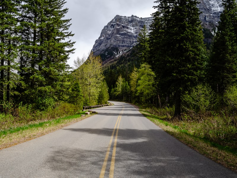 Going-to-the-Sun road running into the distance with a mountain high above