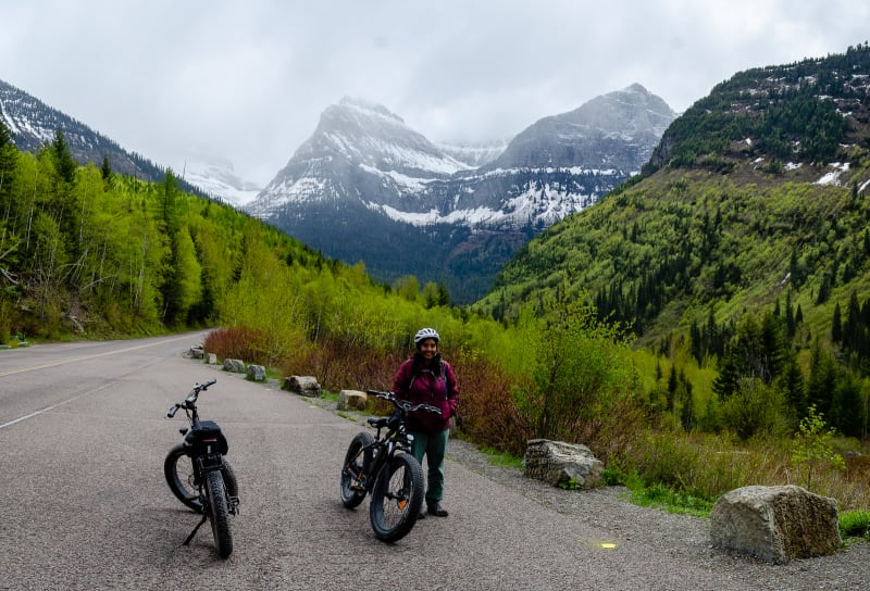 sushila posing with our two bikes at the furthest point we could ride on Going-to-the-Sun road