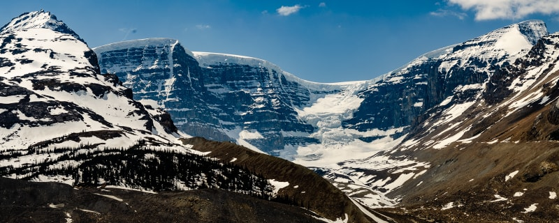 mountain and glacier with the remains of an avalanche visible