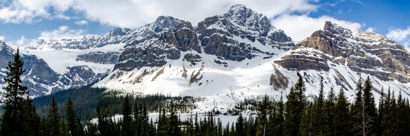 panorama of snowy mountains and a glacier