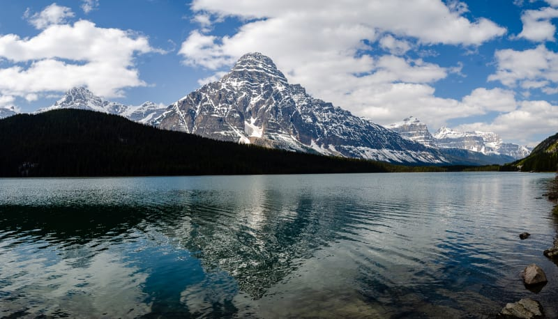 a lake with mountain reflections