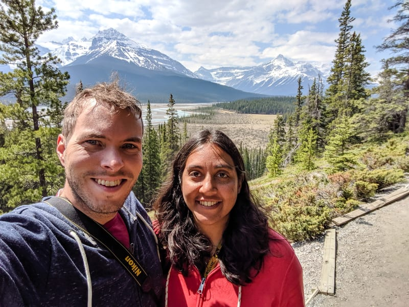 a selfie of sushila and will at an overlook