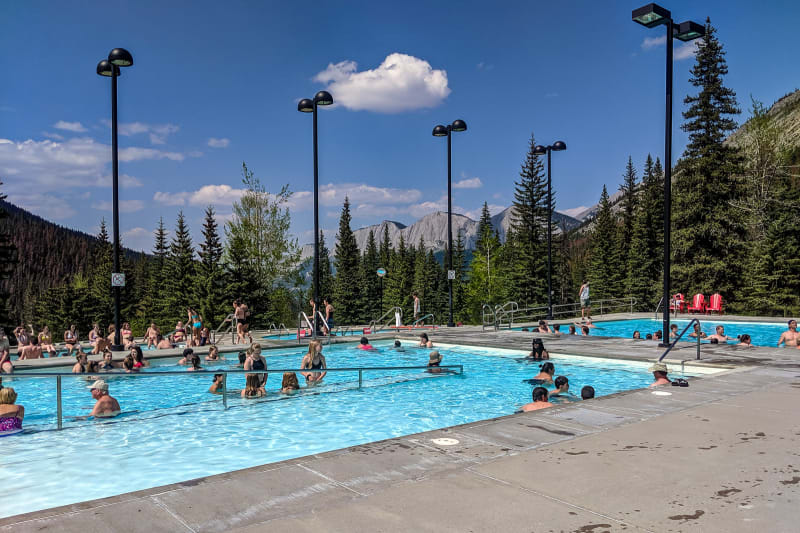miette hot springs surrounded by trees and mountains