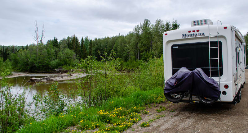 our rv parked along a river in a highway rest area