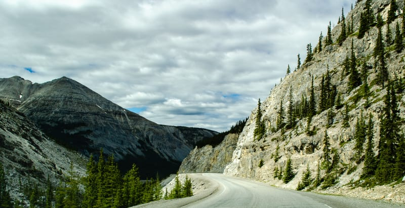 descending into a wide canyon from the high point along the alaska highway