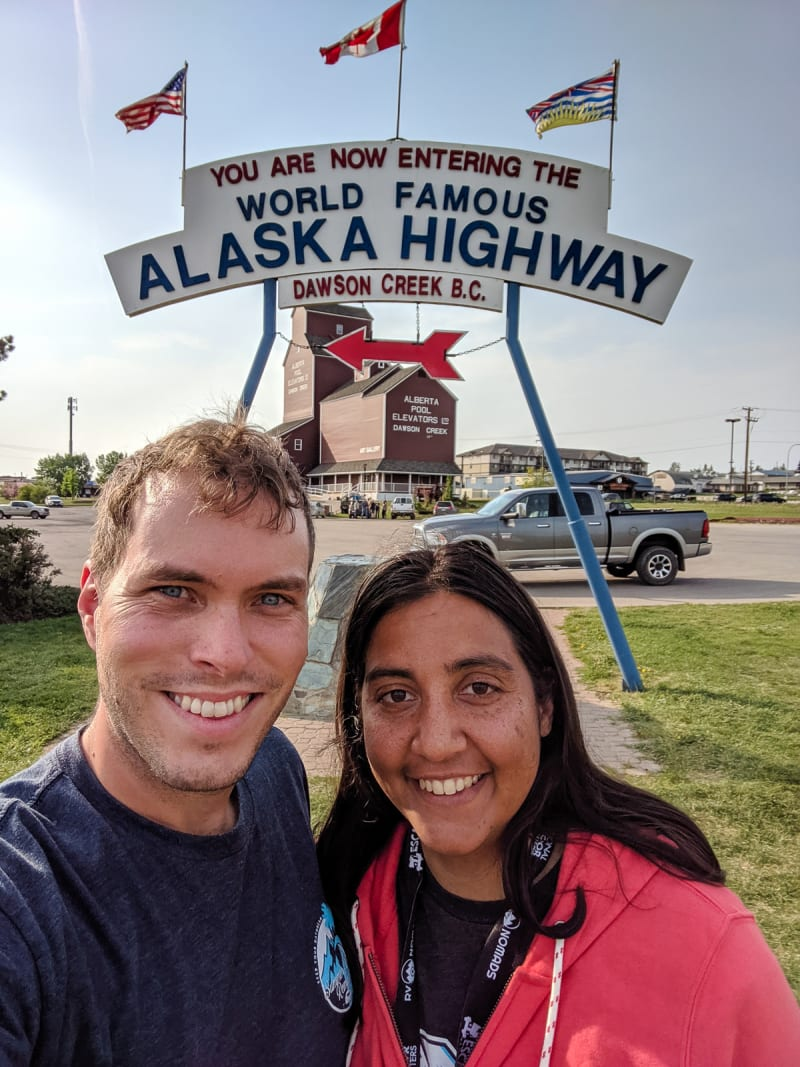 will and sushila taking a selfie in front of the mile 0 sign
