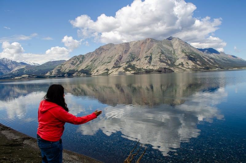 sushila skipping a stone on the lake