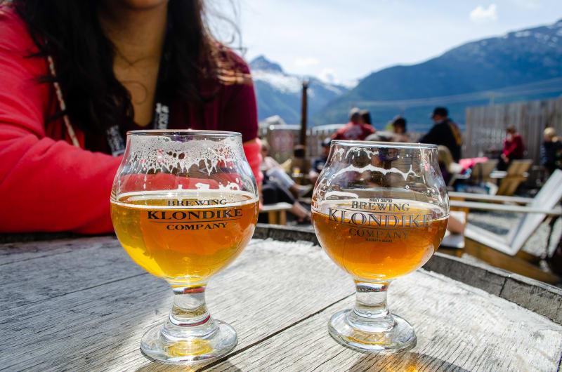 two beer glasses labeled klondike brewing