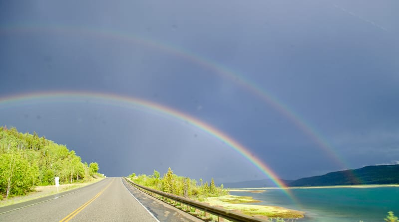 a double rainbow over the road