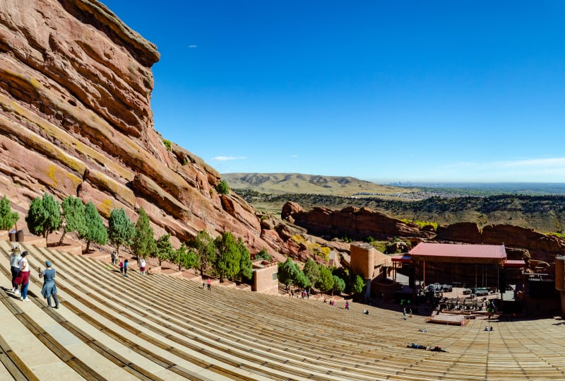 red rocks amphitheatre with denver in the background
