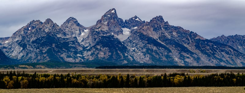 grand Teton standing in stark relief with the surrounding valley