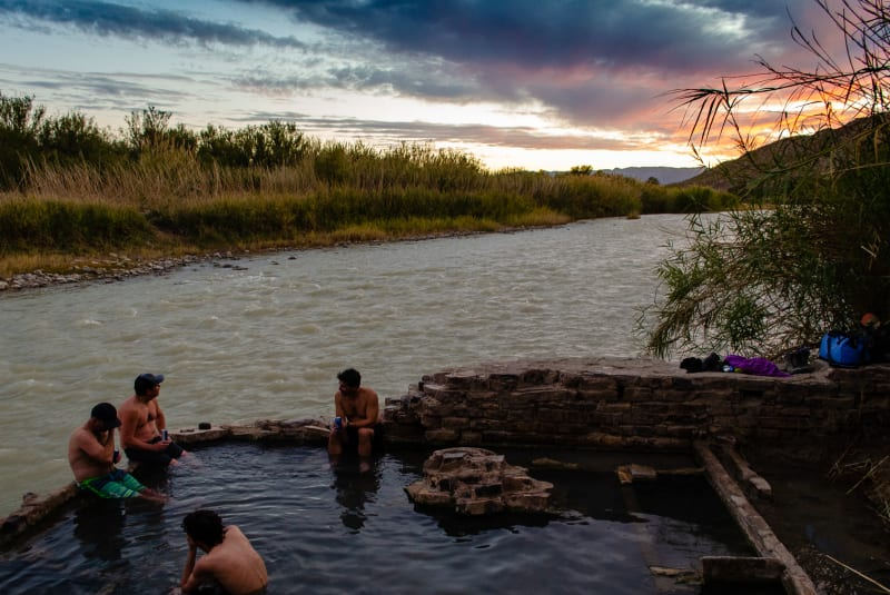 hot springs in a stone-lined pool along side the rio grande river