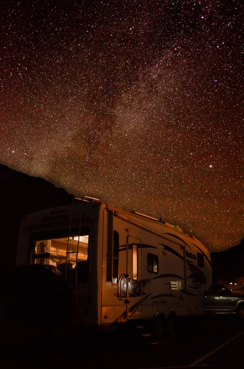 our rv with the milky way and a star-filled sky above