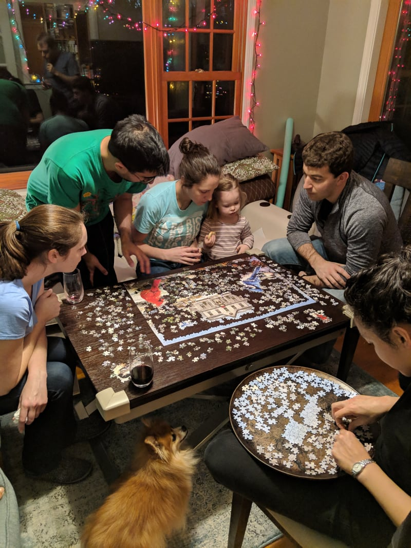people putting together a puzzle