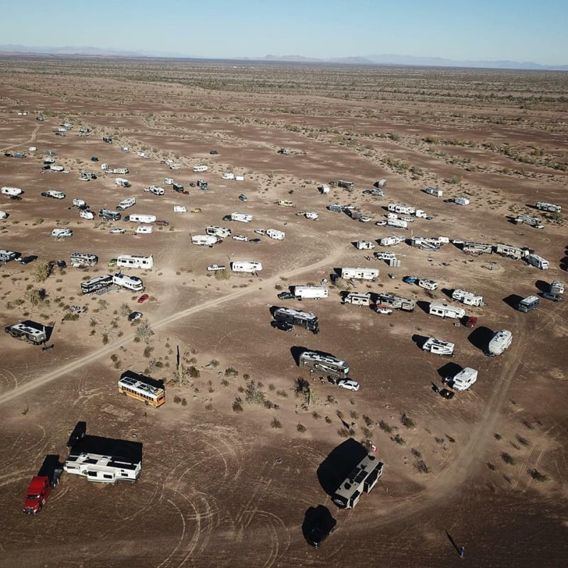 arial shot of rvs camped in the desert