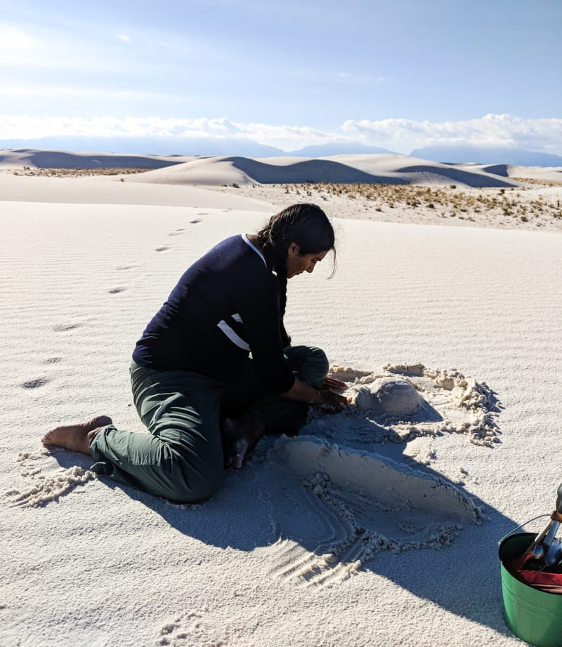 sushila building a castle in the sand
