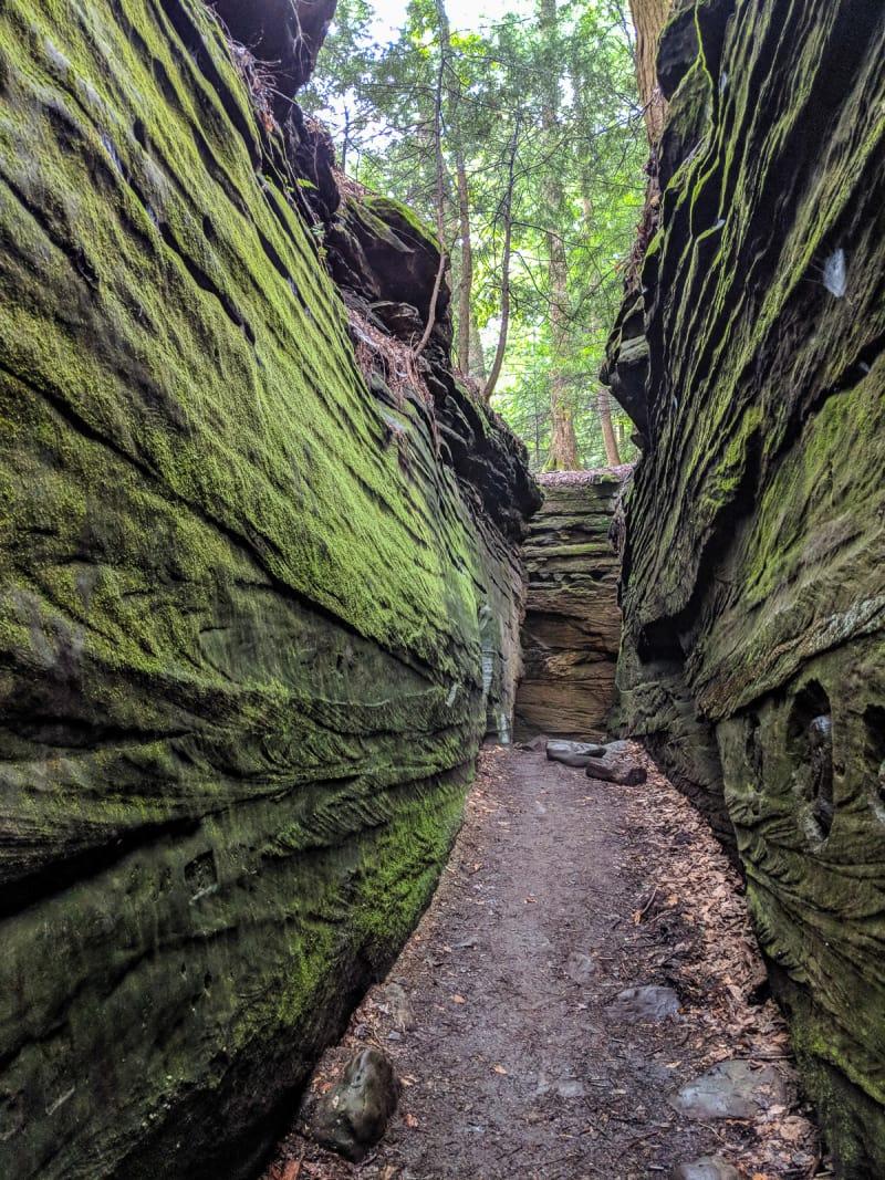 narrow path through rock cliffs