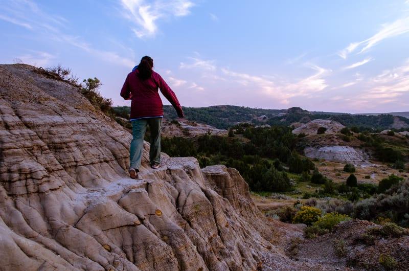 sushila climbing on a badland formation