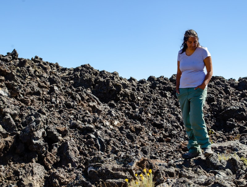 sushila hiking in a lava field