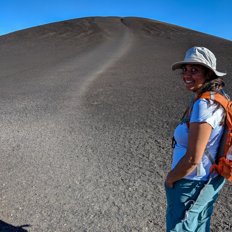 sushila standing at the base of inferno cone