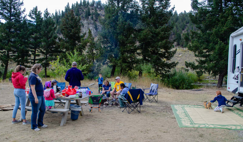 family gathered for a campfire cookout
