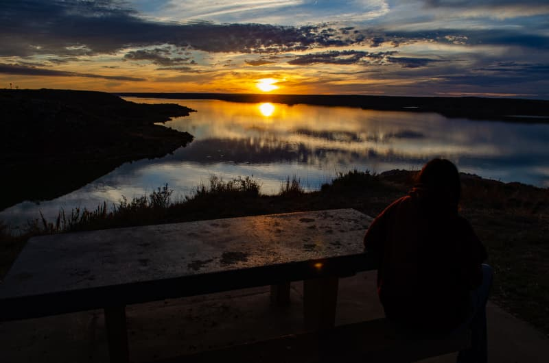 sushila watching the sun set at lake meredith nra