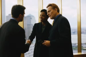 Business People Meeting by Window
