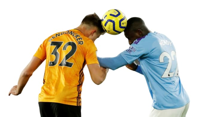 Dendoncker of Wolves and Mendy of Man City contesting for a ball