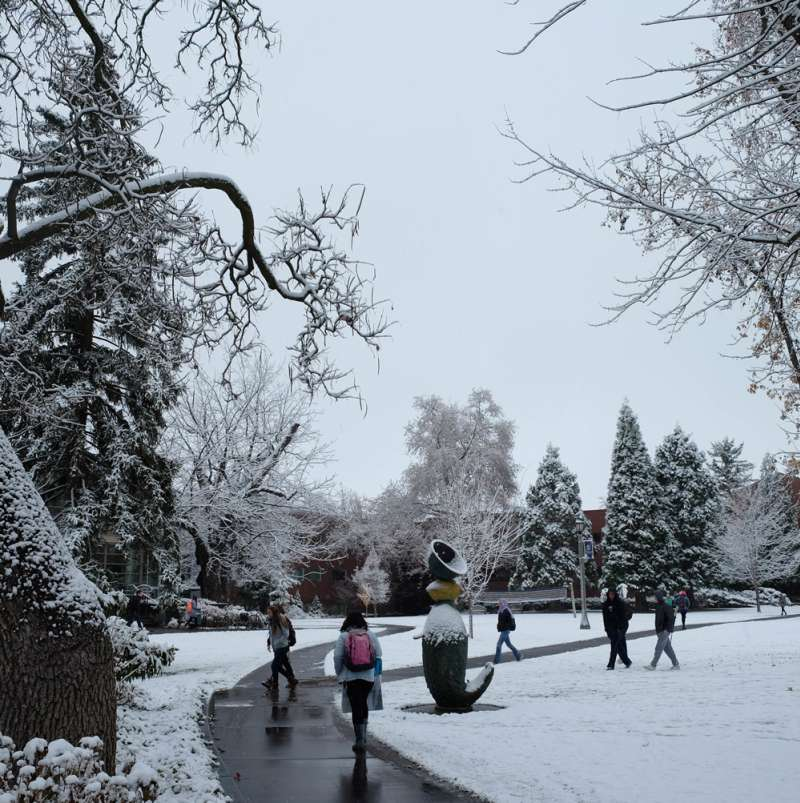 Whitman campus with students in the winter, with some snow on the ground