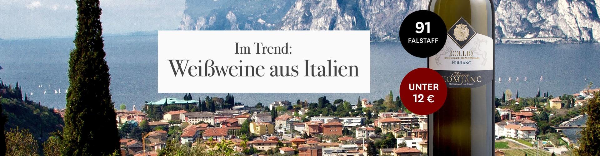 Weißwein aus Italien vor malerischem See mit Bergen