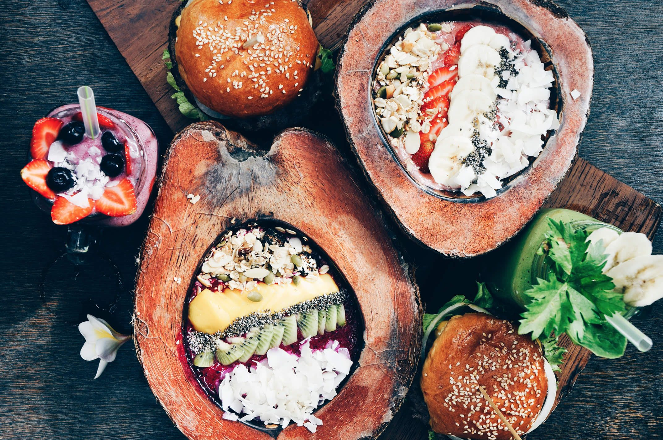 colourful Smoothie Bowls served in Coconut Bowls with burgers and Juices