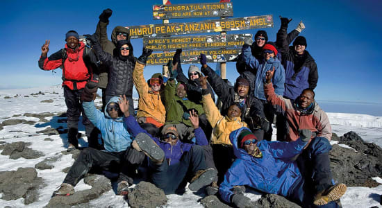 1 slide kilimanjaro trek climbers summit pano