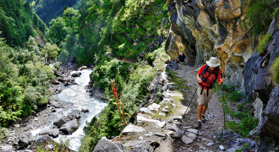 hiker srteam cliff dolpo nepal