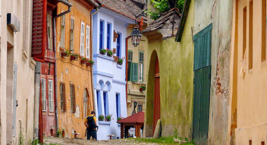 1 slide sighisoara romania hiker colorful old europe houses pano