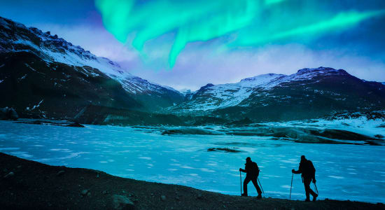 iceland hikers northern lights aurora borealis