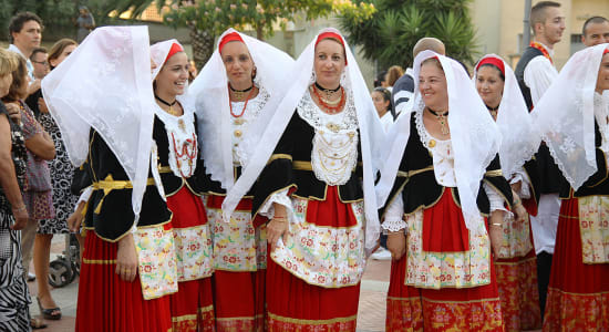 1 slide pagan festival sardinia women traditional dress pano