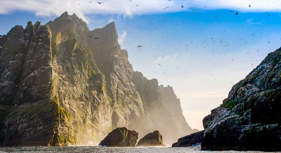 st kilda scotland rocks ocean birds sunset