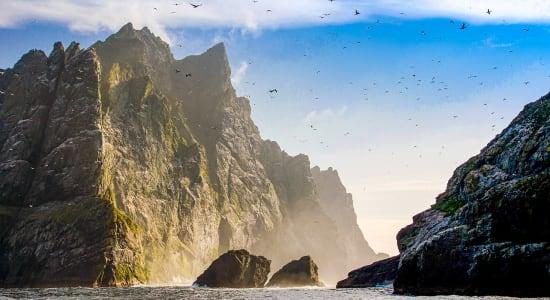 st kilda scotland rocks ocean birds sunset