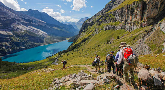 switzerland via alpina lake oeschinensee hikers