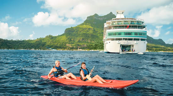 tahiti society islands couple kayaking by boat