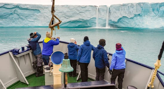 arctic svalbard viewing glacial waterfalls from boat
