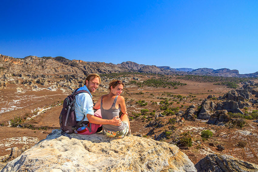 Young hiker couple viewing scenic panorama at Madagascar's Isalo National Park