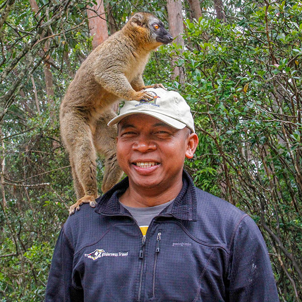 Lemur on shoulder of Wilderness Travel tour guide