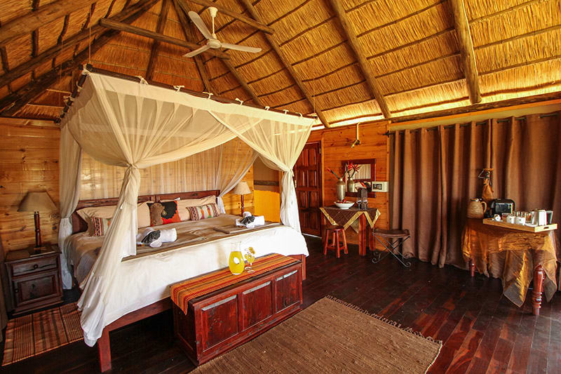 Four-poster bed in villa of safari lodge in Zimbabwe