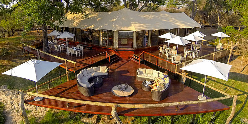 Ariel view of outdoor deck and dining room at Zambezi Sands Lodge in Zimbabwe